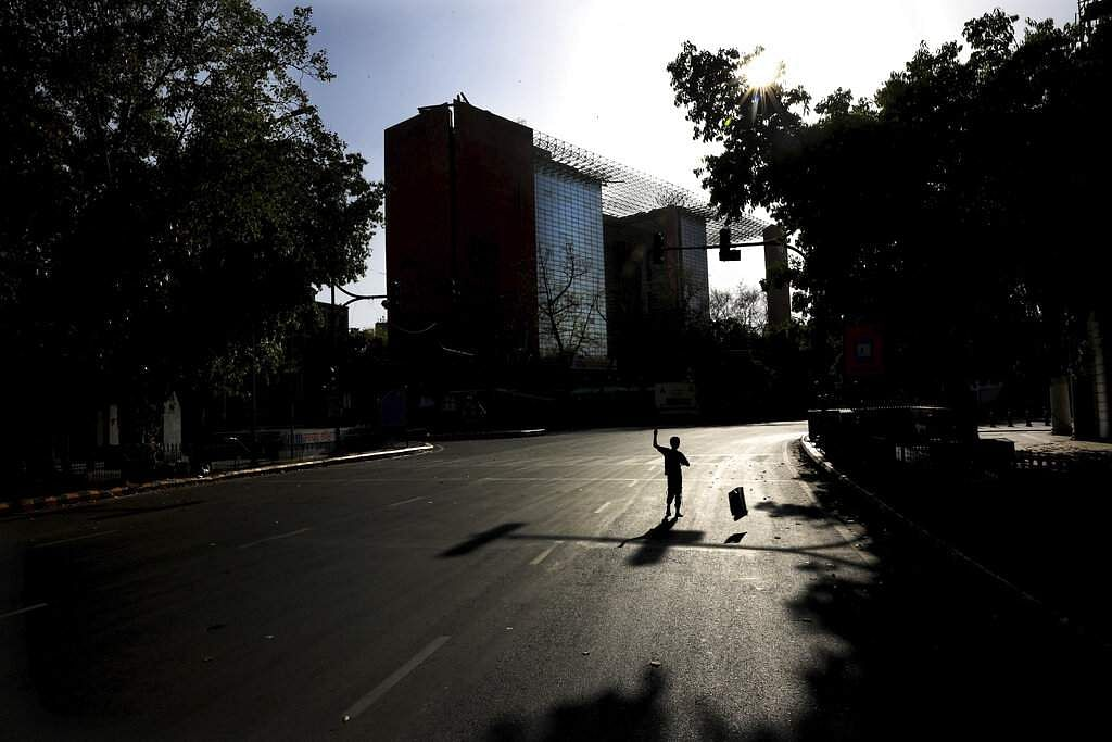 A homeless child tries to fly a kite in the middle of a deserted road during the nationwide lockdown to stop the spread of the novel coronavirus, in New Delhi. (AP Photo/Manish Swarup)