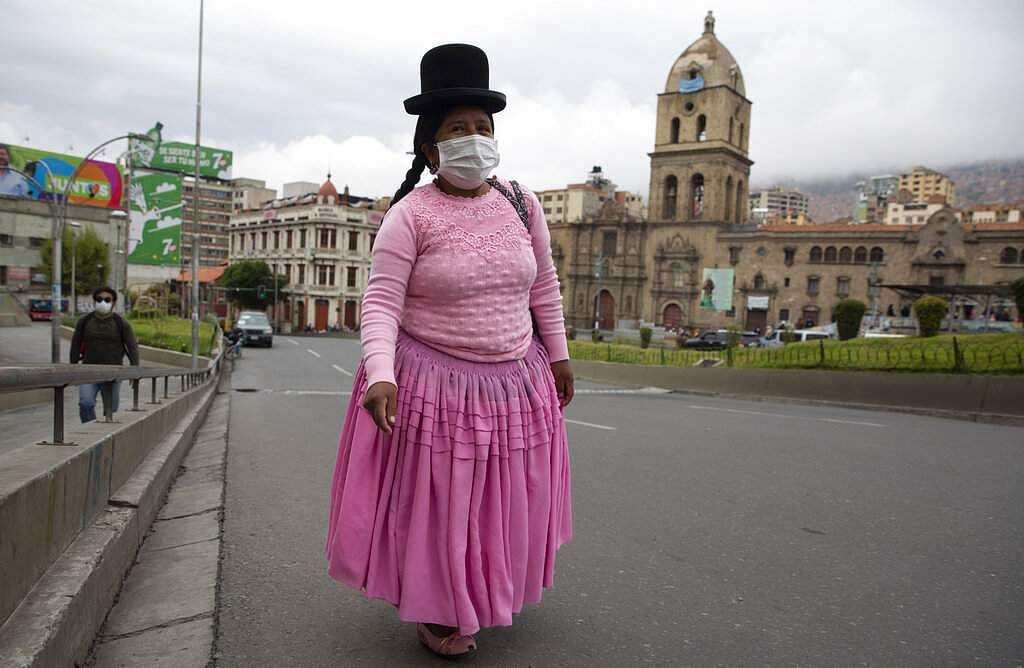 A woman walks in an empty street near the Basilica of San Francisco during a government-ordered lockdown to stop the spread of the novel coronavirus in La Paz, Bolivia. (AP Photo/Juan Karita)