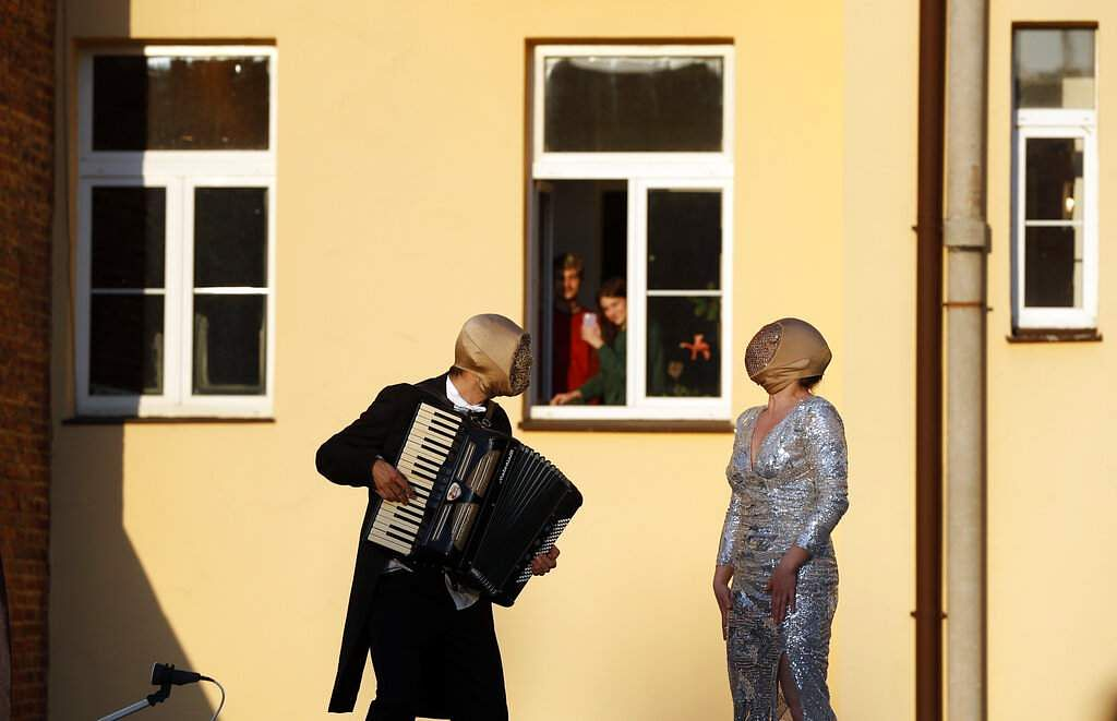 Street musicians entertain residents as people stay indoors to counter the spread of the coronavirus in Prague, Czech Republic. (AP Photo/Petr David Josek)