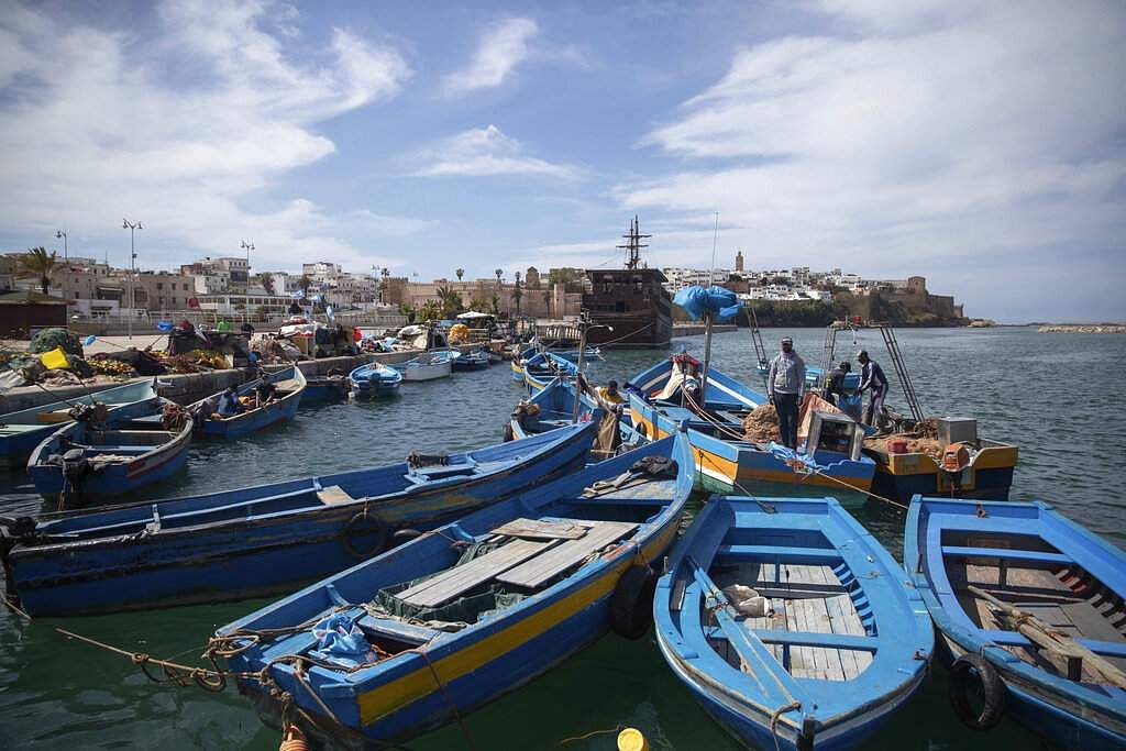 Fishermen moor their boats during a state of emergency and home confinement orders due to coronavirus, in Rabat, Morocco. (AP Photo/Mosa'ab Elshamy)