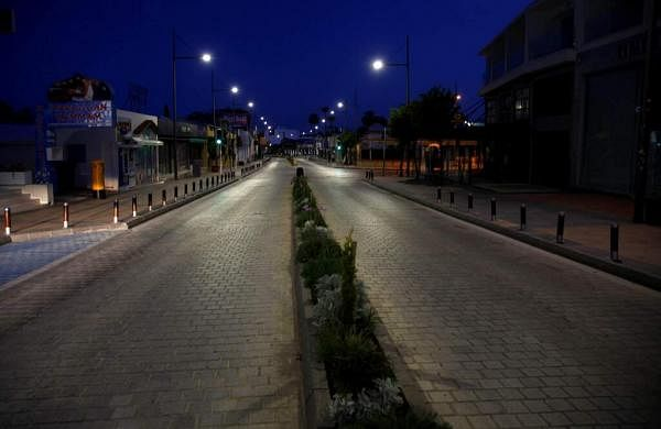 An empty street in the popular Mediterranean resort town of Ayia Napa, Cyprus, which has an international reputation for boisterous parties popular with young foreigners. (AP Photo/Petros Karadjias)