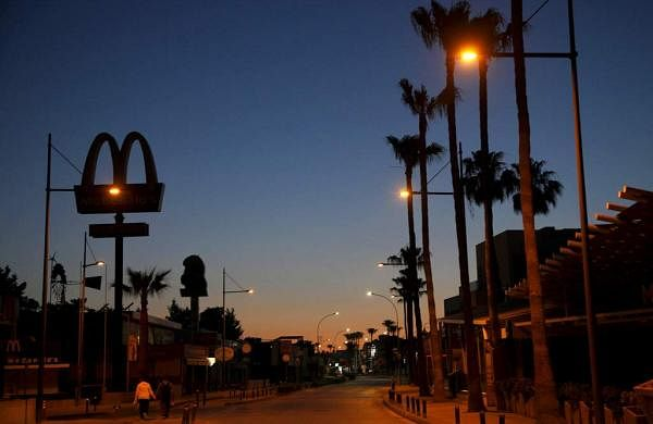 An empty street in the popular seaside Mediterranean resort town of Ayia Napa in Cyprus. The town has a reputation for boisterous parties popular with young foreigners. (AP Photo/Petros Karadjias)
