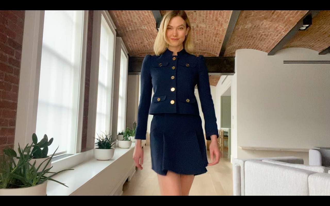 Karlie_Kloss_in_a_navy_suit_with_gold_embellishments