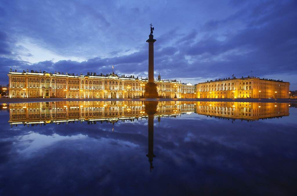Winter Palace and the Alexander Column are reflected in a puddle after the rain at the Palace Square in St Petersburg, Russia. (AP Photo/Dmitri Lovetsky)