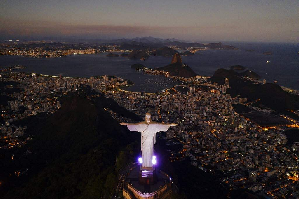 The Christ the Redeemer statue stands above the Guanabara Bay during dusk amid the outbreak of the coronavirus in Rio de Janeiro, Brazil. (AP Photo/Leo Correa)