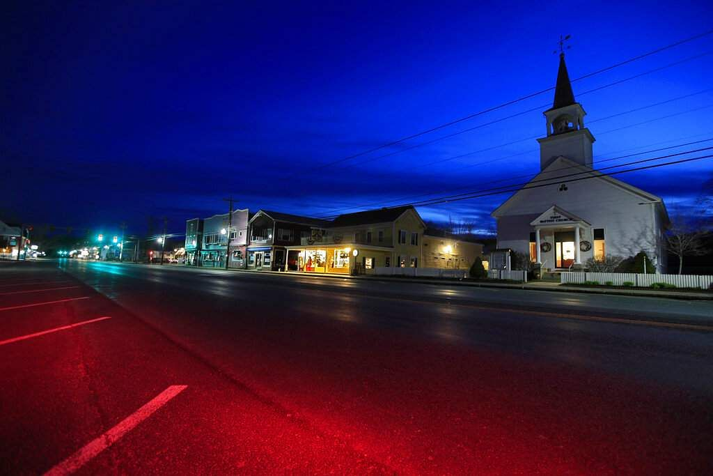 The First Baptist Church and small shops remain closed during the coronavirus pandemic in North Conway, New Hampshire. (AP Photo/Robert F Bukaty)