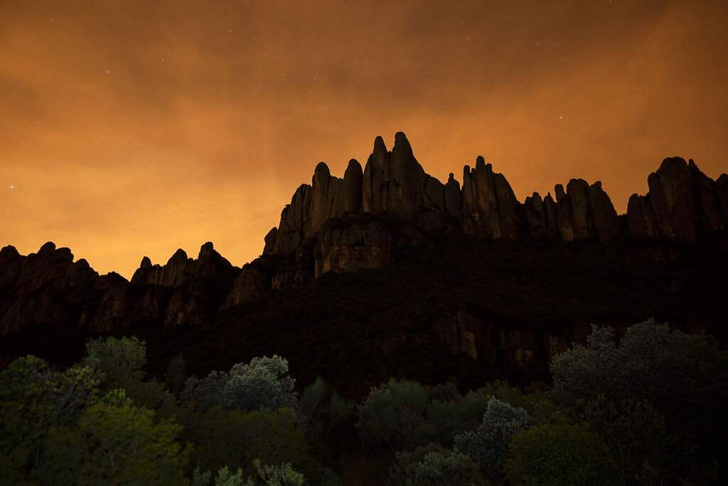 The Montserrat mountain range outside of Barcelona stands as the sun sets during the lockdown to combat the spread of the new coronavirus continues in Spain. (AP Photo/Felipe Dana)