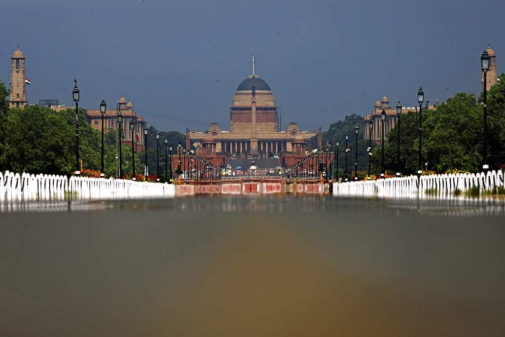 Rajpath, India's ceremonial boulevard is deserted, as India's Presidential Palace is seen during a lockdown amid concerns over the spread of coronavirus in New Delhi, India. (AP Photo/Altaf Qadri)