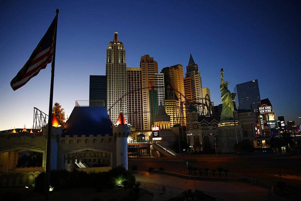 The sun sets along the Las Vegas Strip devoid of the usual crowds and traffic after casinos and other business continue to be shuttered due to the coronavirus in Las Vegas. (AP Photo/John Locher)