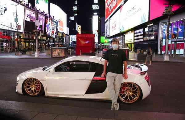 Danny Lin with his 2008 Audi R8 at Times Square (AP Photo/Mark Lennihan)