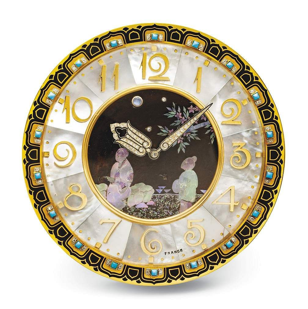 Christie's presents 101 Cartier Clocks on auction on 1 July, at Four Seasons Hotel, Geneva. In pic: Art deco mother-of-pearl, enamel, turquoise, moonstone & diamond desk clock. Est: US $130-190,000.