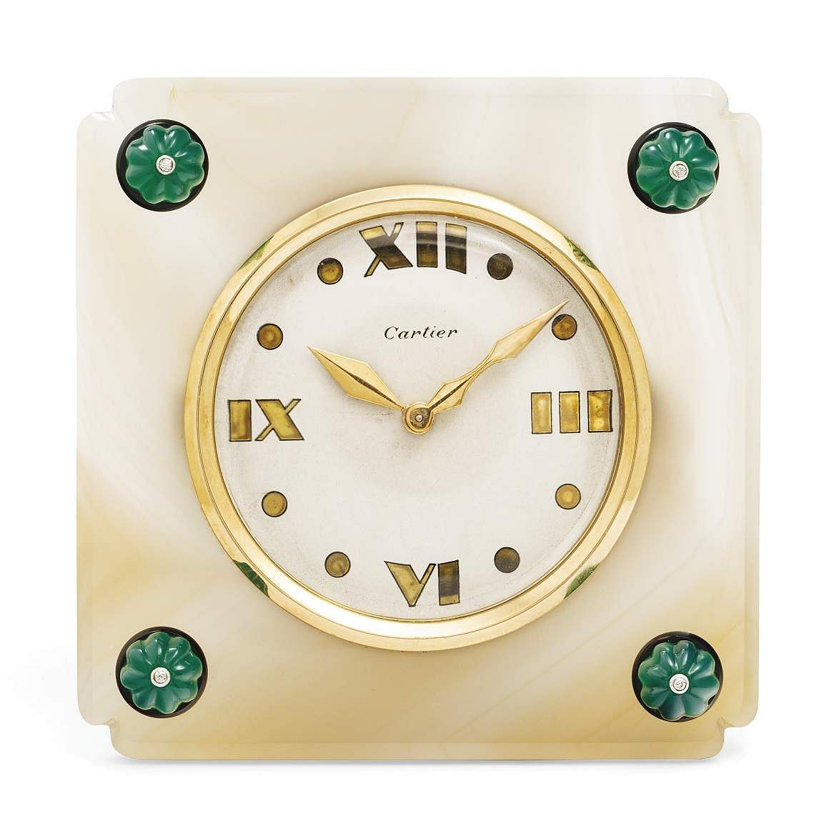 Christie's presents 101 Cartier Clocks on auction on 1 July, at Four Seasons Hotel des Bergues, Geneva. In pic: Retro agate, chrysoprase, diamond & onyx desk clock. Est: US $22-27,000.