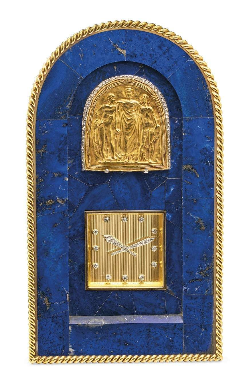 Christie's presents 101 Cartier Clocks on auction on 1 July, at Four Seasons Hotel des Bergues, Geneva. In pic: Mid-20th century Lapis-Lazuli, agate & diamond clock. Est: US $85-130,000.