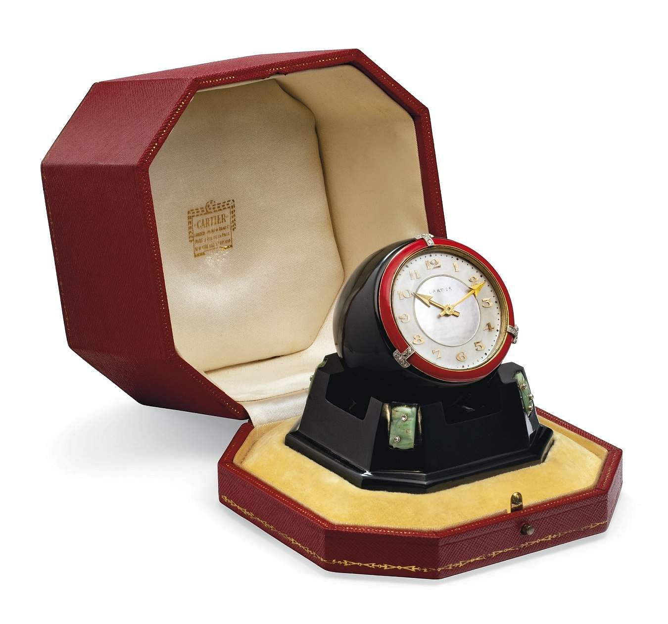 Christie's presents 101 Cartier Clocks on auction on 1 July, at Four Seasons Hotel des Bergues, Geneva. In pic: Art deco mother-of-pearl, onyx, jade & enamel desk clock. Est: US $74-100,000.