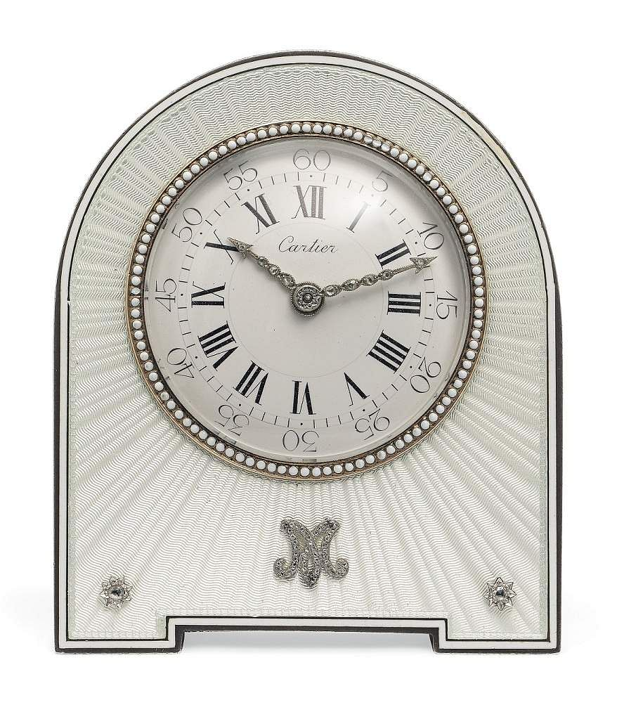 Christie's presents 101 Cartier Clocks on auction on 1 July, at Four Seasons Hotel des Bergues, Geneva. In pic: Belle Epoque enamel, ivory & diamond clock. US $42-52,000.