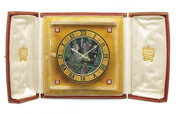 Christie's presents 101 Cartier Clocks on auction on 1 July, at Four Seasons Hotel des Bergues, Geneva. In pic: Art deco mother-of-pearl, Rock crystal, coral & diamond desk clock. Est: US $14-190,000.