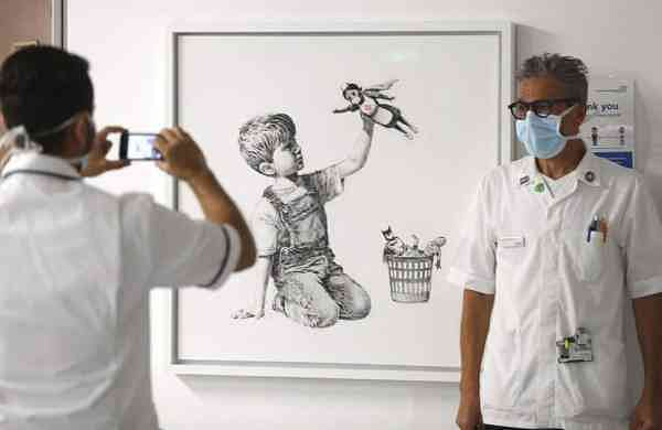 The new artwork by Banksy titled Game Changer (Andrew Matthews/PA via AP)