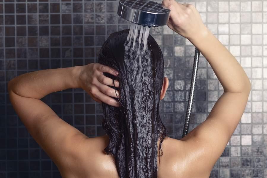 bigstock-Young-Woman-Washing-Her-Long-H-80810930