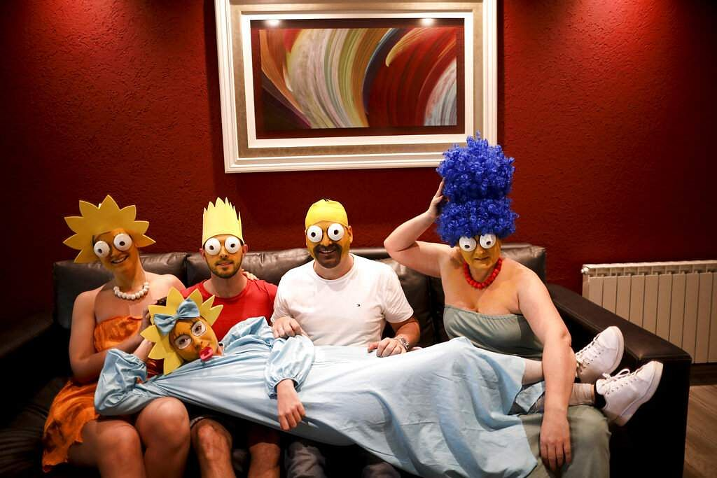 The Arevalo-Robledo family, dressed as The Simpsons (AP Photo/Natacha Pisarenko)