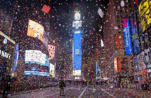 Confetti flies after the Times Square New Year's Eve Ball drops in a nearly empty Times Square AP21001207970177