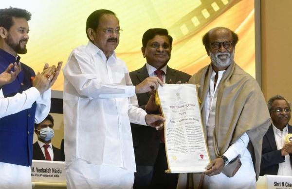 Rajinikanth receives the Dadasaheb Phalke awrd from Vice-President Venkaiah Naidu