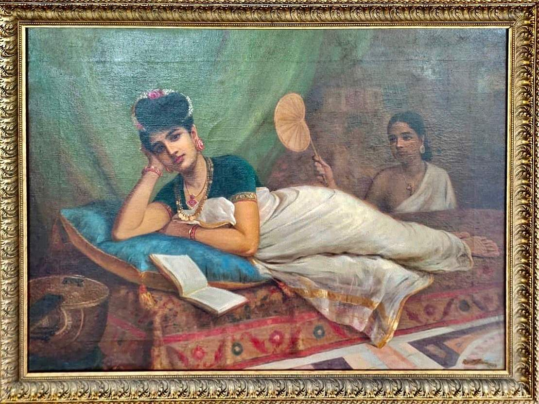 Reclining Nair Lady painted by Raja Ravi Varma