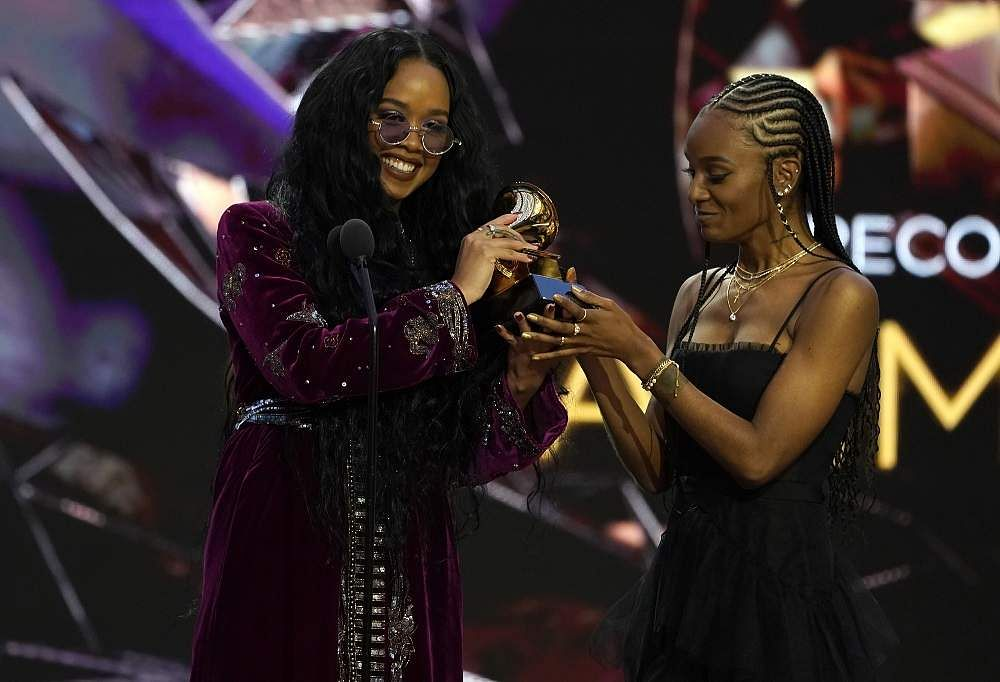 H.E.R., left, and Tiara Thomas accept the award for song of the year for 'I Can't Breathe'at the 63rd annual Grammy Awards at the Los Angeles Convention Center