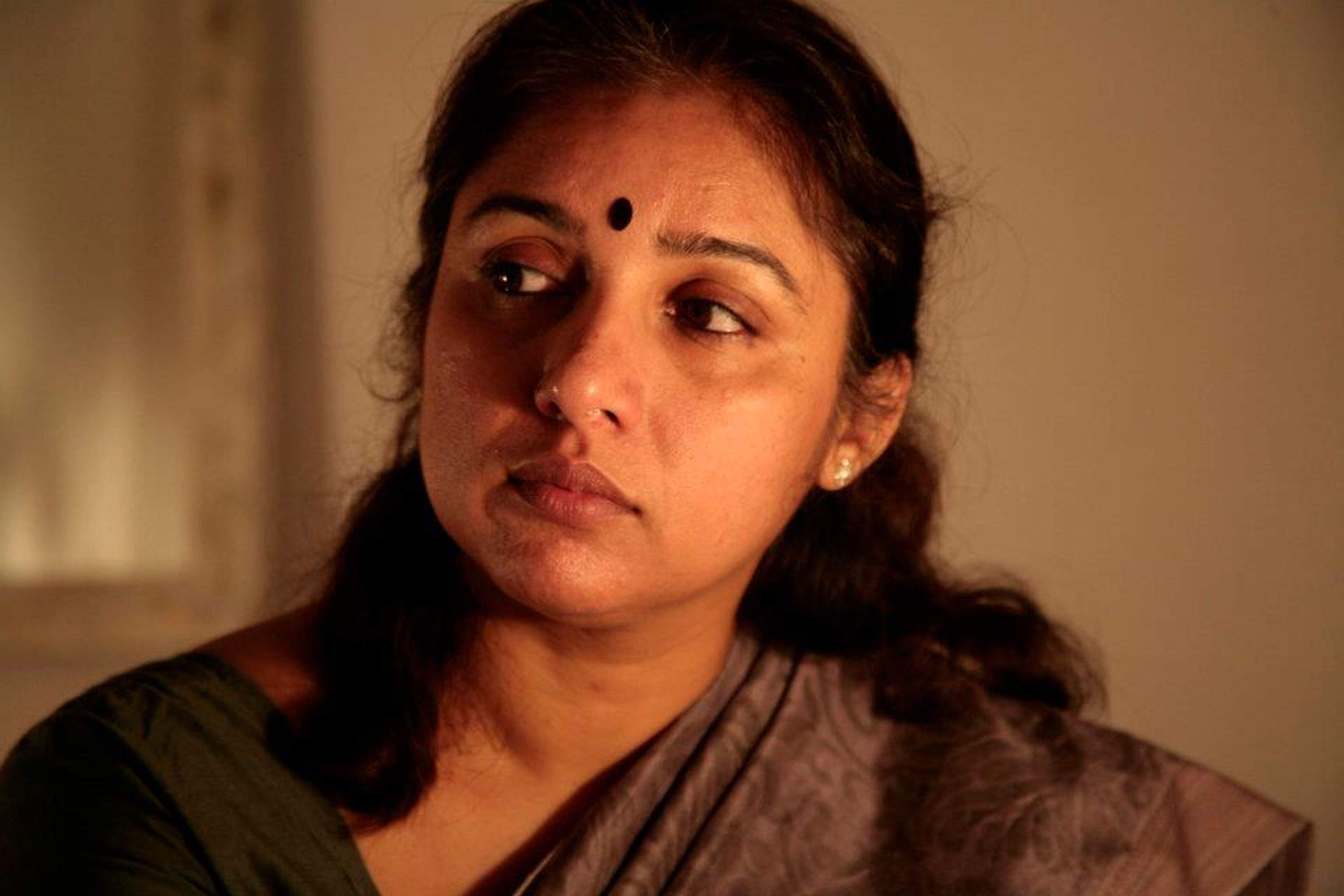 Actress Revathy in a scene from the play