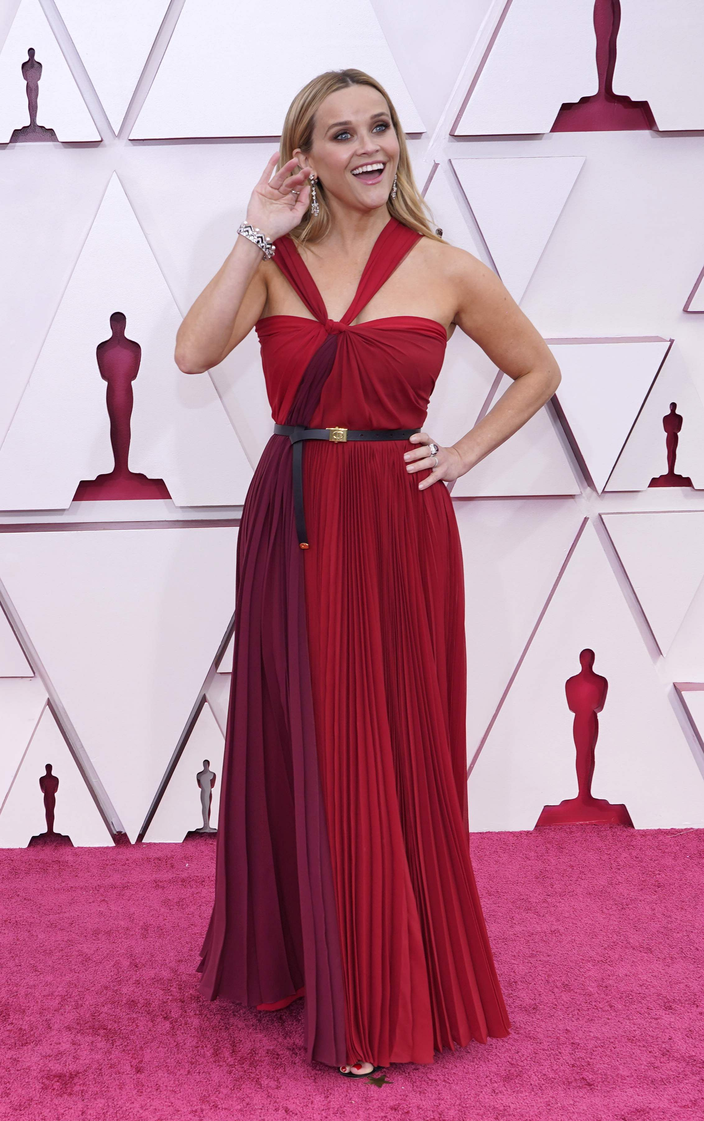 Reese Witherspoon was red haute in a Christian Dior halter-neck dress.Picture: AP
