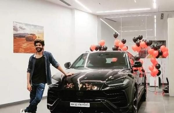 Kartik Aaryan poses next to his newly-purchased Lamborghini Urus