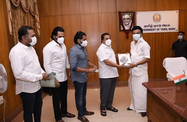 Suriya, Karthi, Sivakumar hand over cheque of Rs 1 crore to MK Stalin