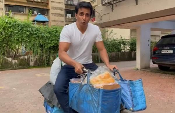 Sonu Sood posts a video where he is seen sitting on a bicycle loaded with groceries