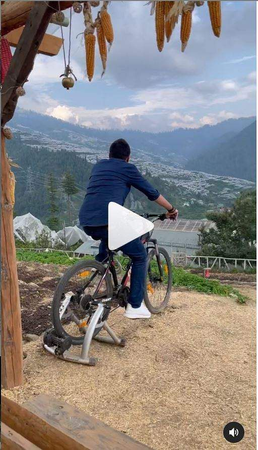 A screenshot from Sakshi Dhoni's Instagram reel in which Dhoni can be seen cycling